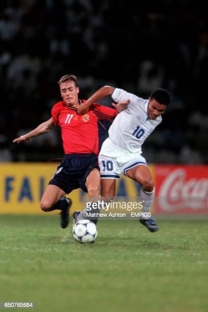Spain's Francisco Yeste Navarro battles for the ball with Honduras' Julio Leon
