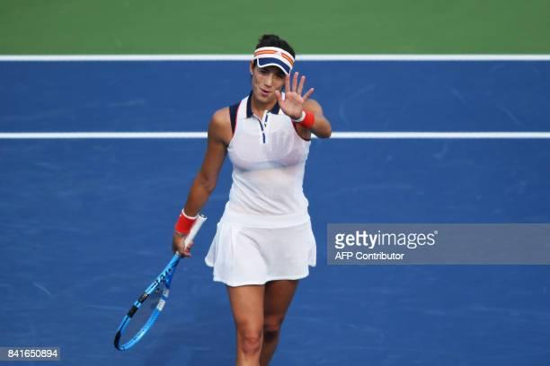 Spain's Garbiñe Muguruza celebrates defeating Slovakia's Magdalena Rybarikova during their 2017 US Open Women's Singles match at the USTA Billie Jean...