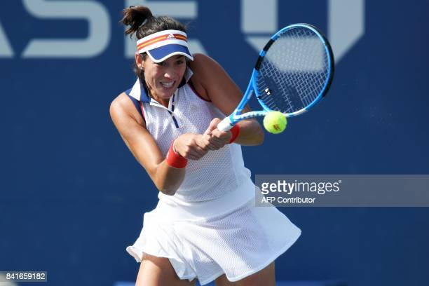 Spain's Garbiñe Muguruza returns the ball to Slovakia's Magdalena Rybarikova during their 2017 US Open Women's Singles match at the USTA Billie Jean...