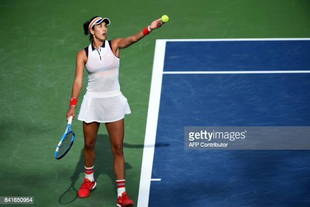 Spain's Garbiñe Muguruza serves the ball to Slovakia's Magdalena Rybarikova during their 2017 US Open Women's Singles match at the USTA Billie Jean...