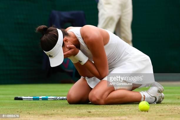TOPSHOT Spain's Garbine Muguruza celebrates after winning against US player Venus Williams during their women's singles final match on the twelfth...