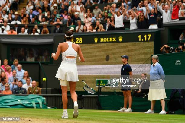 Spain's Garbine Muguruza celebrates after winning against US player Venus Williams during their women's singles final match on the twelfth day of the...