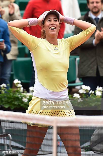 Spain's Garbine Muguruza celebrates after winning her women's semifinal match against Australia's Samantha Stosur at the Roland Garros 2016 French...