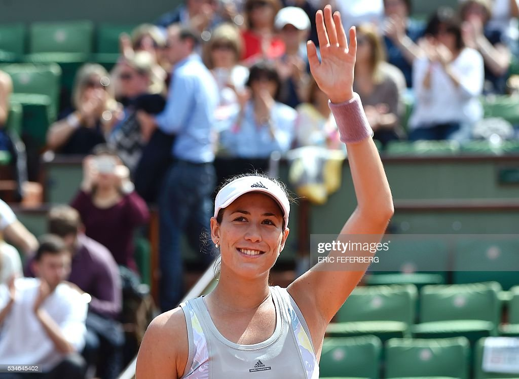 Spain's Garbine Muguruza celebrates after winning her women's third round match against Belgium's Yanina Wickmayer at the Roland Garros 2016 French Tennis Open in Paris on May 27, 2016. / AFP / Eric FEFERBERG