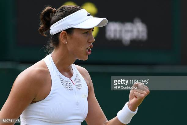 Spain's Garbine Muguruza celebrates wining the first set against Romania's Sorana Cirstea during their women's singles third round match on the sixth...