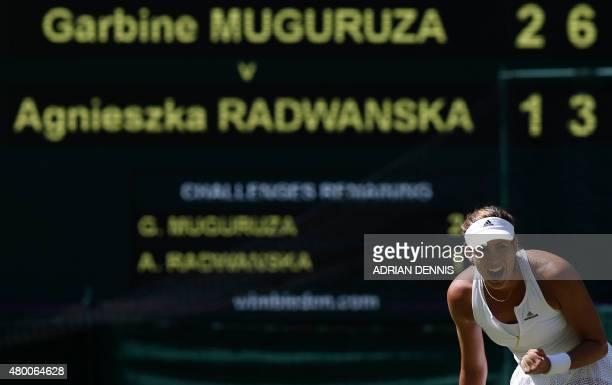 Spain's Garbine Muguruza celebrates winning a point against Poland's Agnieszka Radwanska during their women's semifinal match on day ten of the 2015...
