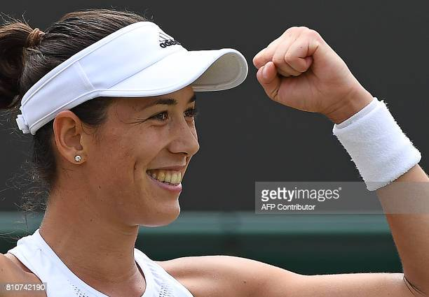 Spain's Garbine Muguruza reacts after winning against Romania's Sorana Cirstea during their women's singles third round match on the sixth day of the...