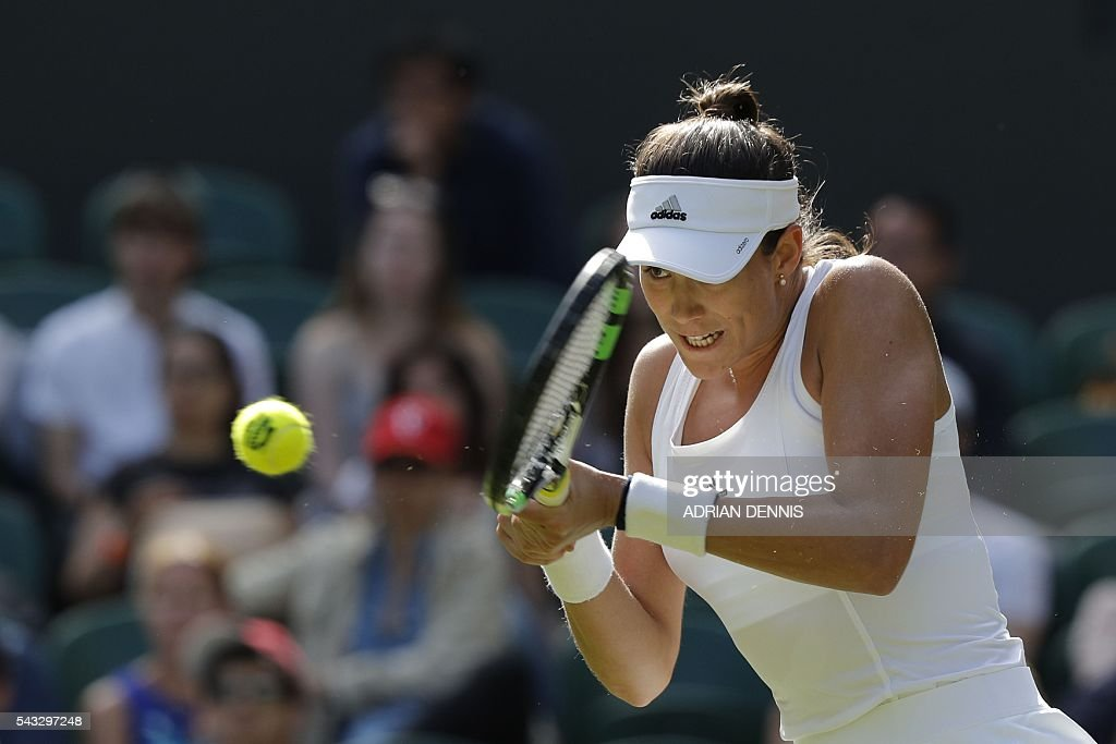 Spain's Garbine Muguruza returns against Italy's Camila Giorgi during their women's singles first round match on the first day of the 2016 Wimbledon Championships at The All England Lawn Tennis Club in Wimbledon, southwest London, on June 27, 2016. / AFP / ADRIAN