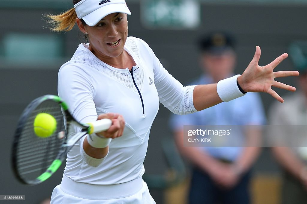 Spain's Garbine Muguruza returns against Slovakia's Jana Cepelova during their women's singles second round match on the fourth day of the 2016 Wimbledon Championships at The All England Lawn Tennis Club in Wimbledon, southwest London, on June 30, 2016. / AFP / GLYN