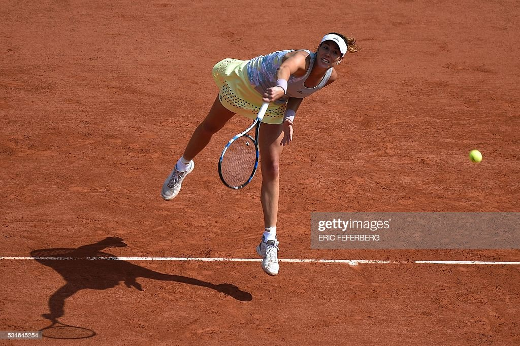 Spain's Garbine Muguruza serves the ball to Belgium's Yanina Wickmayer during their women's third round match at the Roland Garros 2016 French Tennis Open in Paris on May 27, 2016. / AFP / Eric FEFERBERG