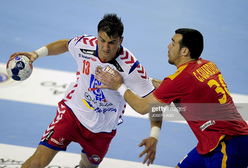Spain's Gedeon Guardiola Villaplana (R) vies with Serbia's Momir Ilic (L) during the handball pre-Olympic qualifying match between Spain and Serbia at the Tecnificacion Center sports hall in Alicante on April 6, 2012.