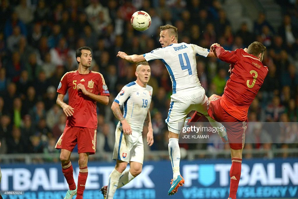 Spain's Gerard Pique and Slovakia's Jan Durica fight for a ball during Euro 2016 qualifing football match between Slovakia and Spain in northern...