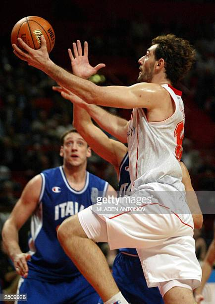 Spain's Giacomo Galanda goes for a basket 13 September 2003 during the semifinals of the mens FIBA 2003 European basketball championships at the...