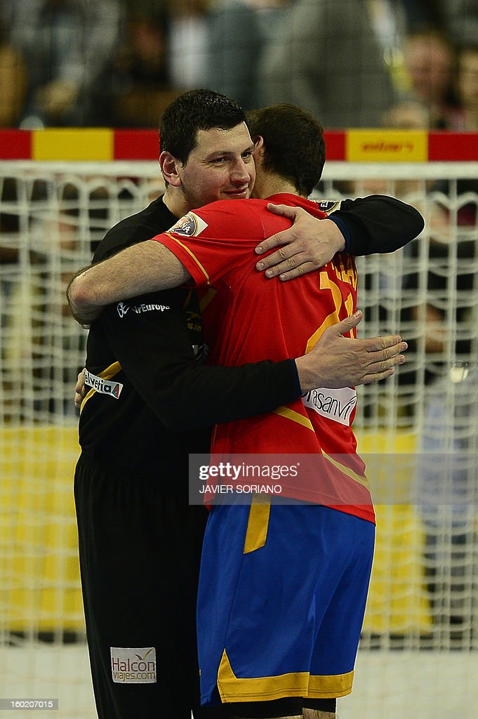 Spain's goalkeeper Arpad Sterbik (L) and Spain's centre back Joan Canellas celebrate their victory at the end of the 23rd Men's Handball World Championships final match Spain vs Denmark at the Palau Sant Jordi in Barcelona on January 27, 2013.