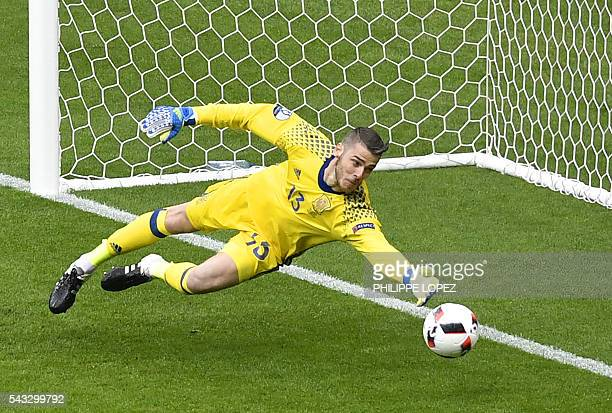 Spain's goalkeeper David De Gea dives for the ball during Euro 2016 round of 16 football match between Italy and Spain at the Stade de France stadium...