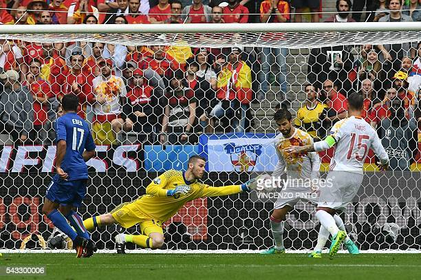TOPSHOT Spain's goalkeeper David De Gea jumps for the ball during the Euro 2016 round of 16 football match between Italy and Spain at the Stade de...