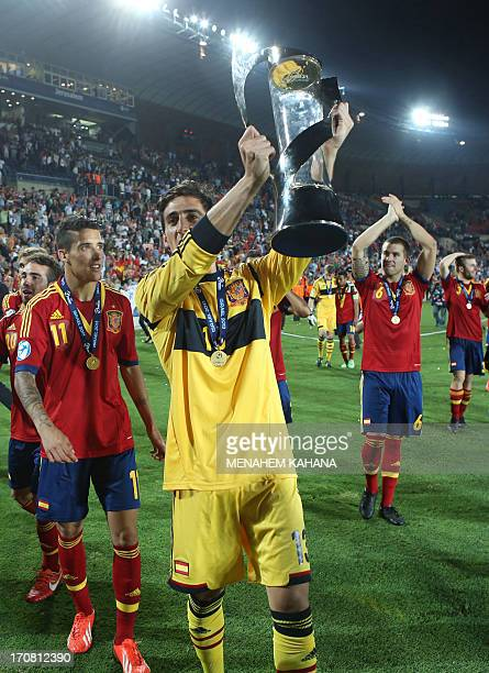 Spain's goalkeeper Diego Marino celebrates with the trophy after beating Italy in their 2013 UEFA U21 Championship final football match at Teddy...