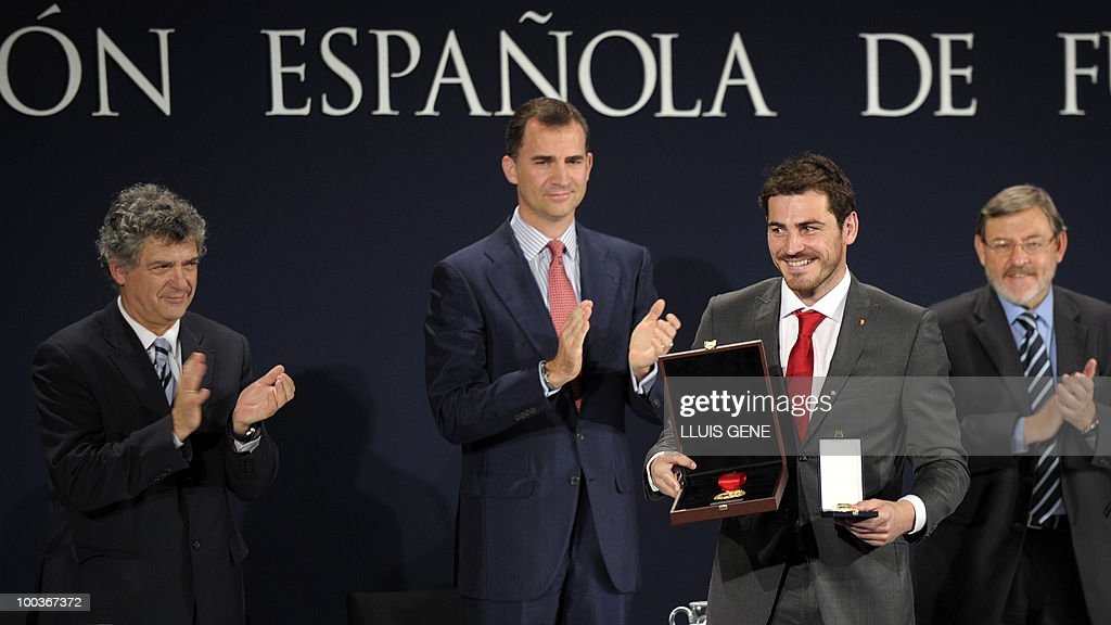 Spain's goalkeeper Iker Casillas (2R) holds his Gold Medal for Sports Merit next to the President of the Spanish Football Federation (RFEF) Angel Maria Villar (L), Spain's Prince Felipe (2L), Sport Secretary of State Jamie Lissavetzky during the inaguration of RFEF museum on May 24, 2010 at the Sports City of Las Rozas, near Madrid. Spain, among the favourites for the World Cup, which runs from June 11-July 11, face Switzerland, Honduras and Chile in Group H of the opening round.