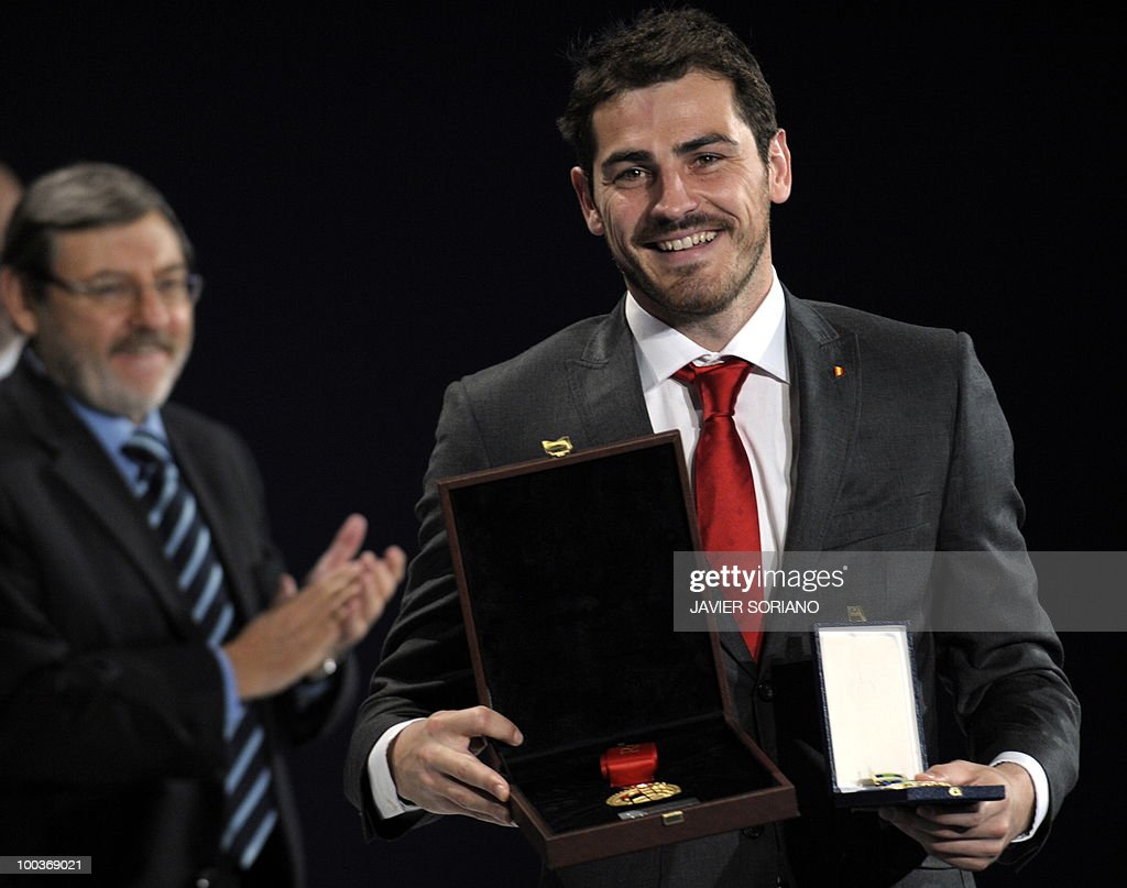 Spain's goalkeeper Iker Casillas holds his Gold Medal for Sports Merit after being awarded the medal during the inauguration of RFEF museum on May 24, 2010 at the Sports City of Las Rozas, near Madrid. Spain, among the favourites for the World Cup, which runs from June 11-July 11, face Switzerland, Honduras and Chile in Group H of the opening round.
