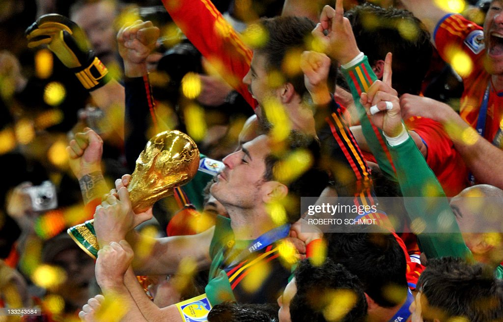 Spain's goalkeeper Iker Casillas kisses the trophy during the award ceremony following the 2010 FIFA football World Cup between the Netherlands and Spain on July 11, 2010 at Soccer City stadium in Soweto, suburban Johannesburg. NO