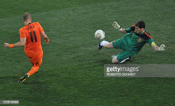 Spain's goalkeeper Iker Casillas pulls off a save with his legs from a shot by the Netherlands' striker Arjen Robben during the 2010 World Cup...