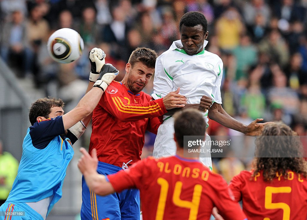 Spain's goalkeeper Iker Casillas (L) punches the ball as teammate Gerard Pique (C) vies with Saudi's Osama (R) during their friendly football match between Spain and Saudi Arabia in Innsbruck on May 29, 2010 prior to the FIFA World Cup 2010 hosted by South Africa.