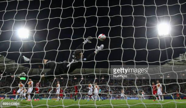 Spain's goalkeeper Kepa Arrizabalaga Revuelta dives for the ball during the UEFA U21 European Championship Group B football match Portugal v Spain on...