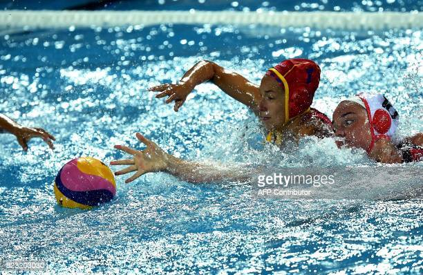 Spain's goalkeeper Laura Ester Ramos fights for the ball with Canada's Christine Robinson during the semifinal water polo match between Canada and...