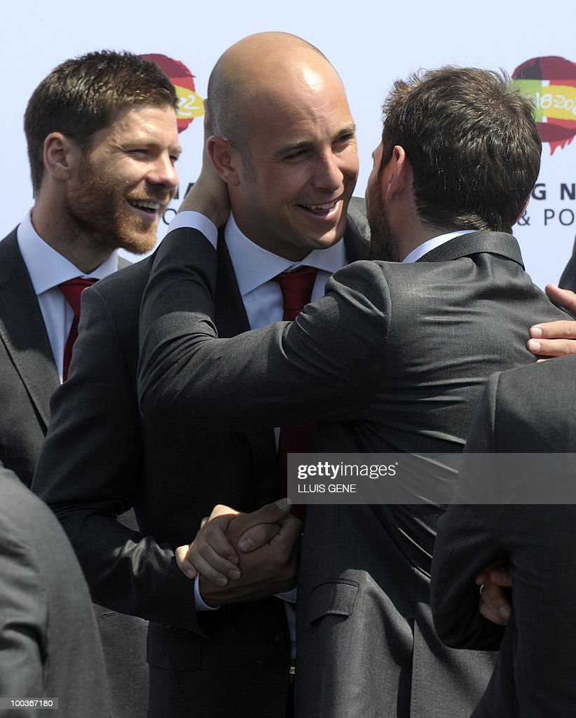 Spain's goalkeepers Pepe Reina (L) and Iker Casillas (R) gather for a group picture of the Spanish football team with Spain's Prince Felipe on May 24, 2010, at the Sports City of Las Rozas, near Madrid. Spain, among the favourites for the World Cup, which runs from June 11-July 11, face Switzerland, Honduras and Chile in Group H of the opening round.