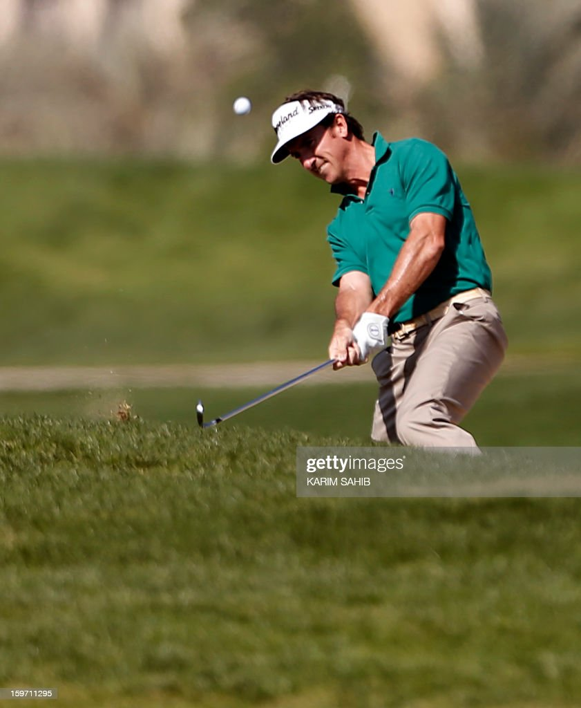 Spain's Gonzalo Fernandez-Castano plays a shot during the third round of the Abu Dhabi Golf Championship at the Abu Dhabi Golf Club in the Emirati capital on January 19, 2013. AFP PHOTO/KARIM SAHIB