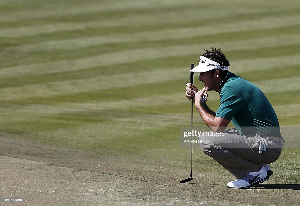 Spain's Gonzalo Fernandez-Castano plays a shot during the third round of the Abu Dhabi Golf Championship at the Abu Dhabi Golf Club in the Emirati capital on January 19, 2013.