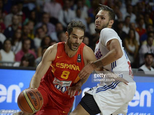 Spain's guard Jose Calderon vies with France's guard Evan Fournier during the 2014 FIBA World basketball championships quarterfinal match France vs...