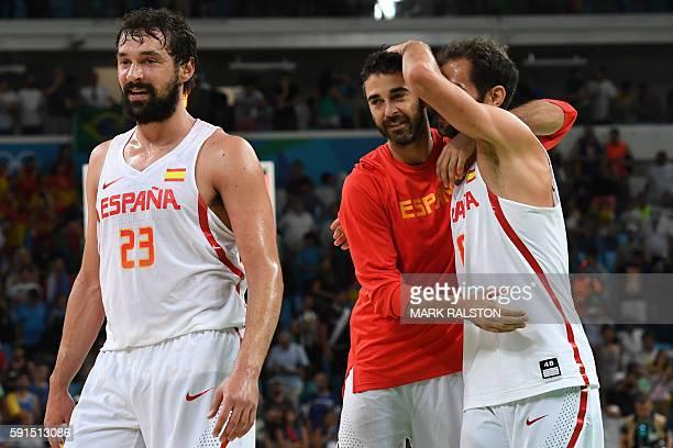 Spain's guard JuanCarlos Navarro celebrates with Spain's point guard Jose Manuel Calderon after winning the Men's quarterfinal basketball match...