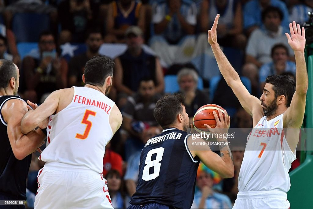Spain's guard JuanCarlos Navarro defends against Argentina's point guard Nicolas Laprovittola during a Men's round Group B basketball match between...
