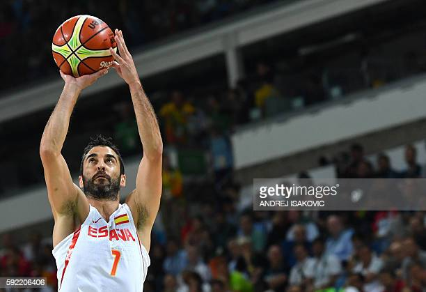 Spain's guard JuanCarlos Navarro jumps for a basket during a Men's semifinal basketball match between Spain and USA at the Carioca Arena 1 in Rio de...