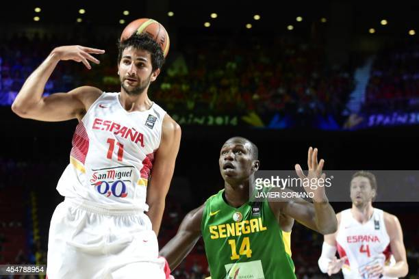 Spain's guard Ricky Rubio vies with Senegal's centre Gorgui Dieng during the 2014 FIBA World basketball championships round of 16 match Spain vs...