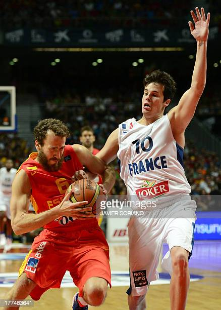 Spain's guard Sergio Rodriguez vies with France's guard Thomas Heurtel during the friendly basketball match Spain vs France at the Palacio de...