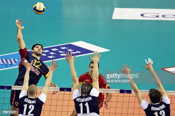 Spain's Guillermo Falasca smashes the ball against Olli Kunnari Mikko Esko and Janne Heikkinen of Finland during the men's European Olympic...