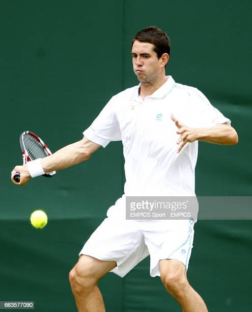 Spain's Guillermo GarciaLopez in action against Argentina's Agustin Calleri during the Wimbledon Championships 2009 at the All England Tennis Club