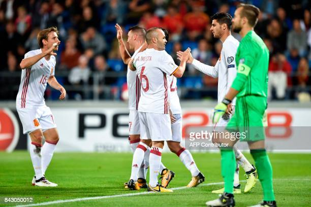 Spain's Iago Aspas celebrates with teammates after scoring a goal against Liechtenstein's goalkeeper Peter Jehle during the FIFA World Cup 2018...
