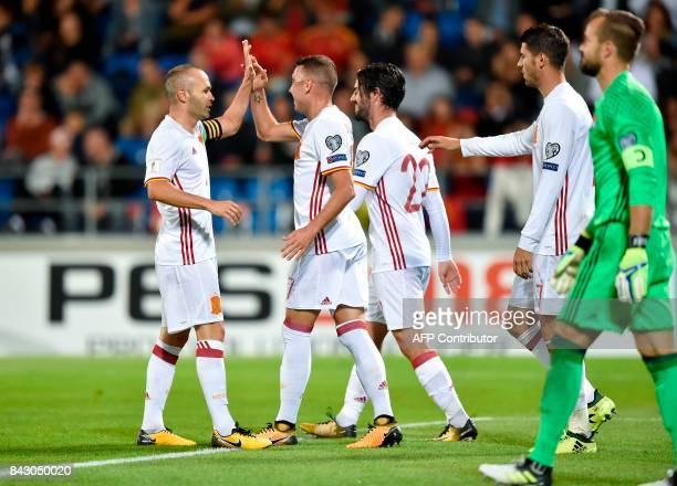 Spain's Iago Aspas celebrates with teammates Andres Iniesta Isco and Alvaro Morata after scoring a goal against Liechtenstein's goalkeeper Peter...