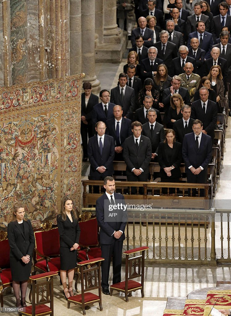 Spain's Infanta Elena, Spain's Princess Letizia, Spain's Crown Prince Felipe and Spanish Prime Minister leader Mariano Rajoy (R) attend a memorial service for the victims the derailed train of Angrois, at the cathedral of Santiago de Compostela on July 29, 2013. The driver of a train that hurtled off the rails in Spain was charged on July 28 with 79 counts of reckless homicide and released on bail after being questioned by a judge.