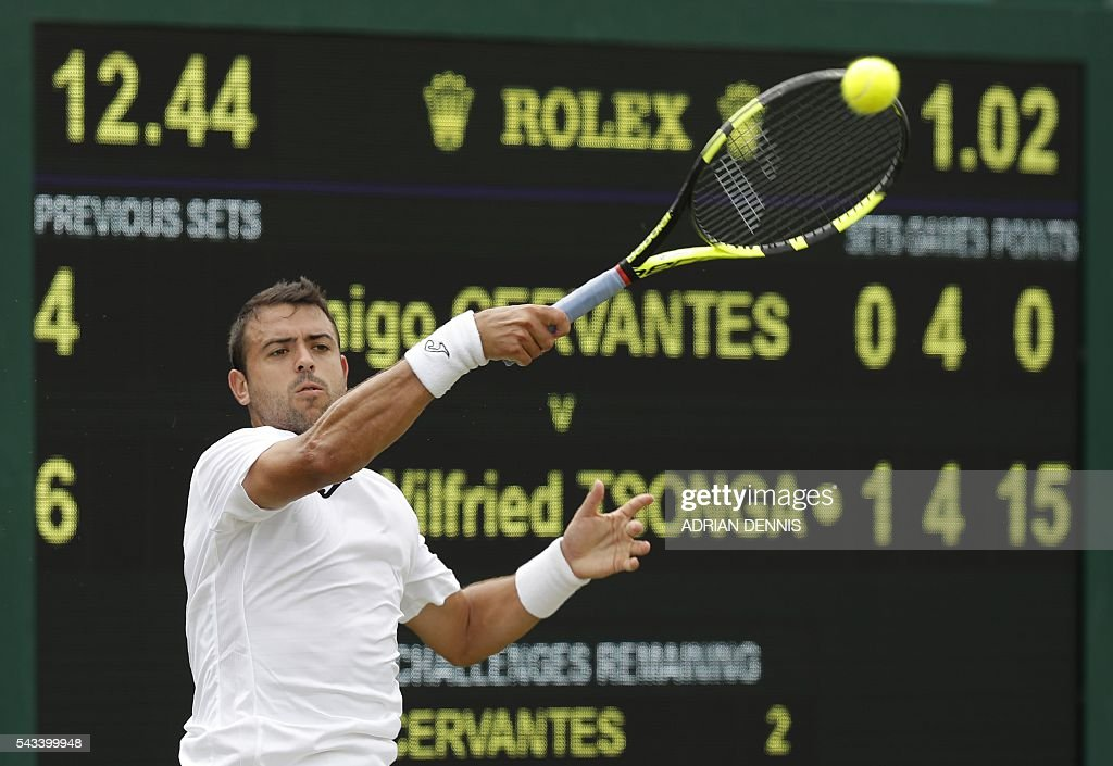 Spain's Inigo Cervantes returns agianst France's Jo-Wilfried Tsonga during their men's singles first round match on the second day of the 2016 Wimbledon Championships at The All England Lawn Tennis Club in Wimbledon, southwest London, on June 28, 2016. / AFP / ADRIAN