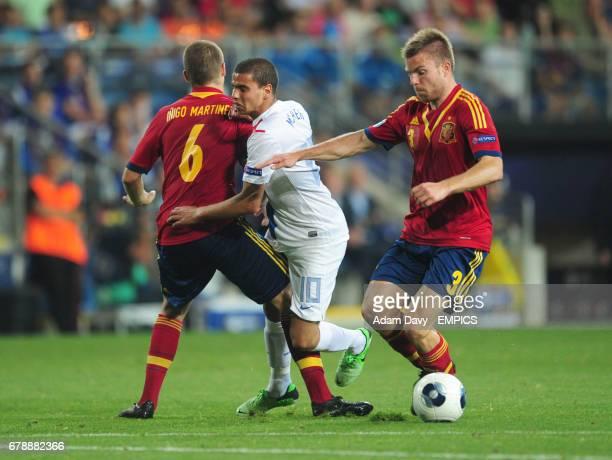 Spain's Inigo Martinez and Asier Illarramendi combine to stop Netherland's Adam Maher