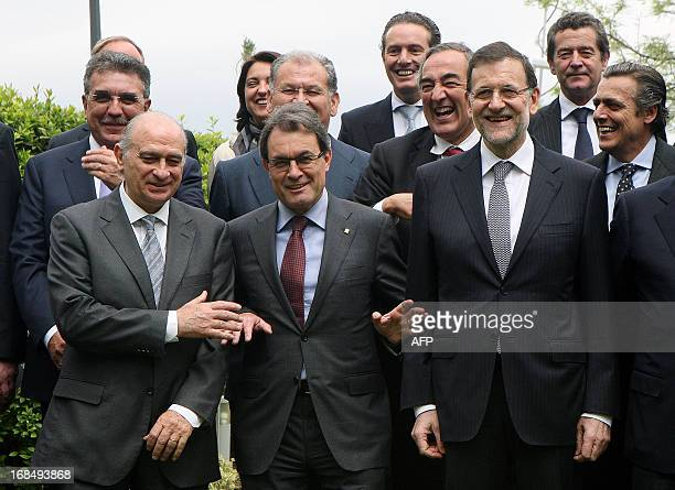 Spain's Interior Minister Jorge Fernandez Diaz President of the Catalonian regional government Artur Mas and Spain's Prime Minister Mariano Rajoy...