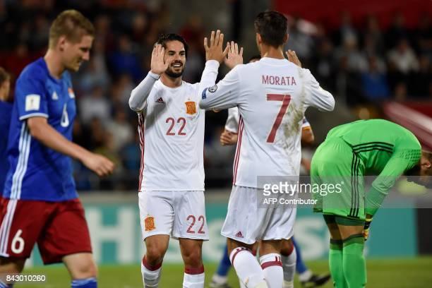 Spain's Isco celebrates with teammate Alvaro Morata after scoring a goal during the FIFA World Cup 2018 qualification football match between...