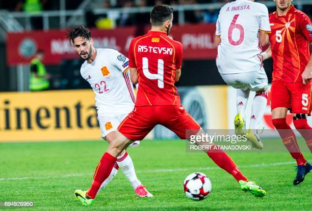 Spain's Isco vies with Macedonia's Kire Ristevski during the FIFA World Cup 2018 qualification football match between Macedonia and Spain at the...