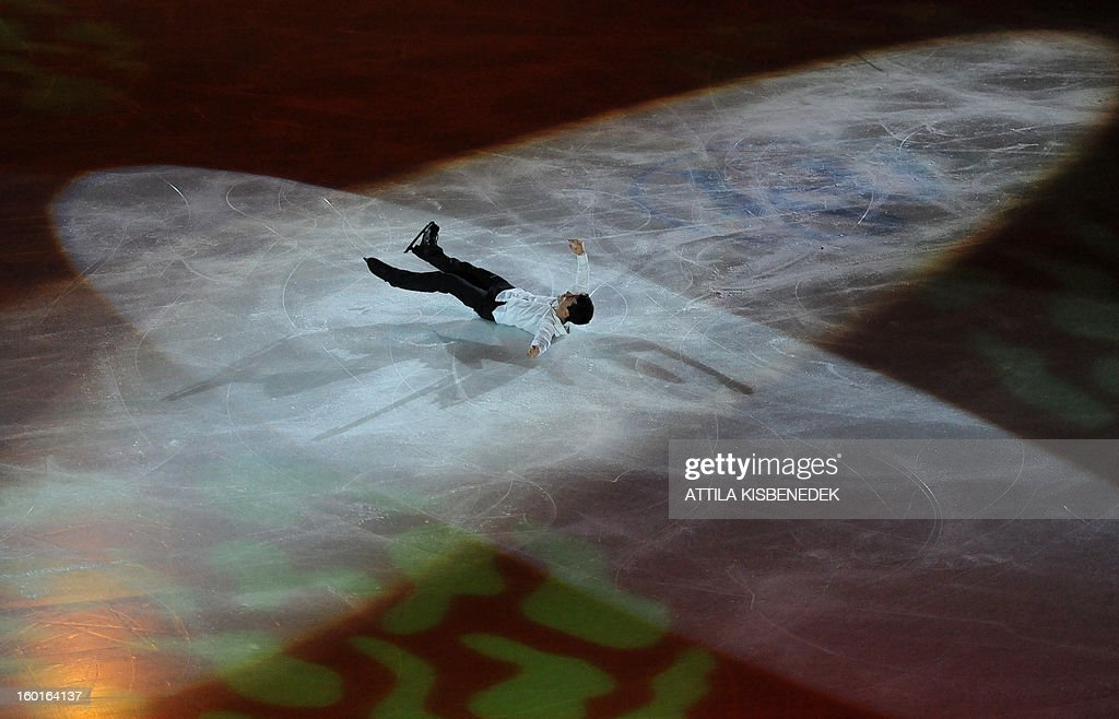 Spain's Javier Fernandez lays on ice as he performs his finish at the 'Dom Sportova' sports hall in Zagreb on January 27, 2013 during the gala of the ISU European Figure Skating Championships.