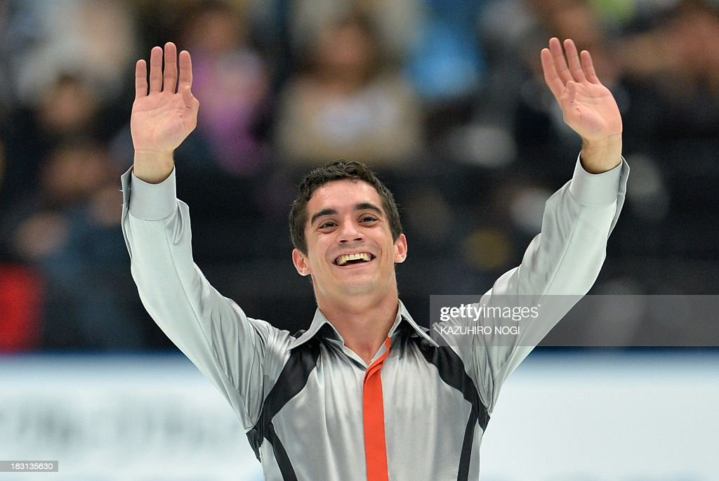Spain's Javier Fernandez waves to fans after his performance in the men's free skating at the Japan Open figure skating competition at Saitama Super Arena in Saitama on October 5, 2013. Fernandez finished top score with a 176.91 points in the event. AFP PHOTO / KAZUHIRO NOGI