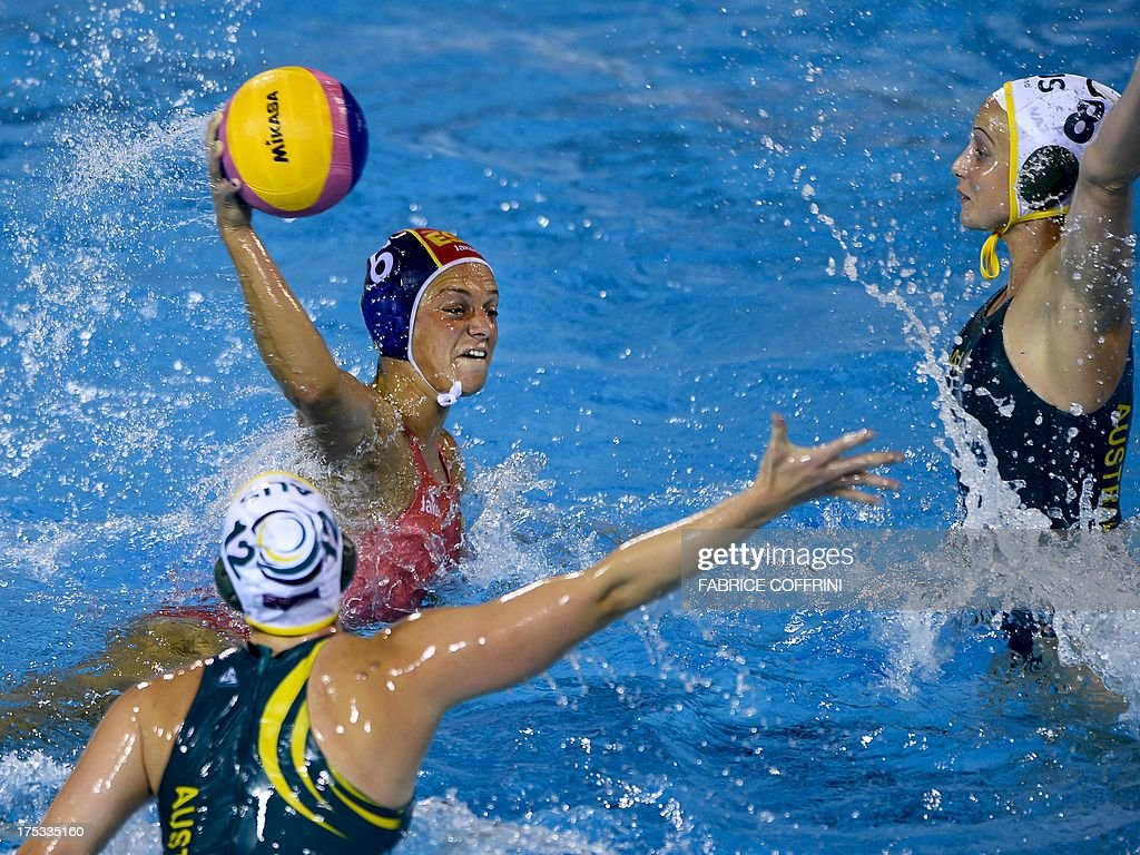 Spain's Jennifer Pareja fires a shot between Australia's Nicolas Zagame and Glencora McGhie during the gold medal final match between Australia and...